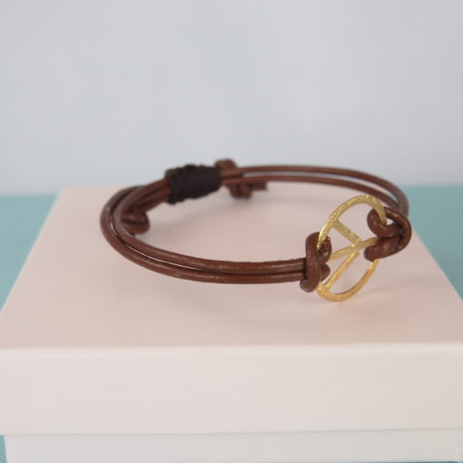 """""""Symbol of Peace, gold""""- Armbånd i læder og guld"""