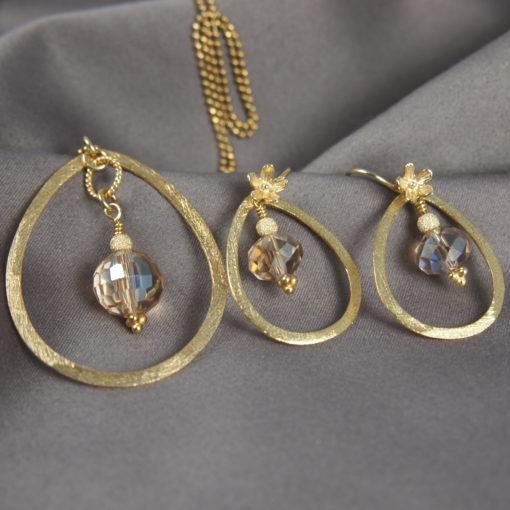 """""""Magnolia""""-Halskæde og øreringe i guld, sølv og oxideret sølv"""